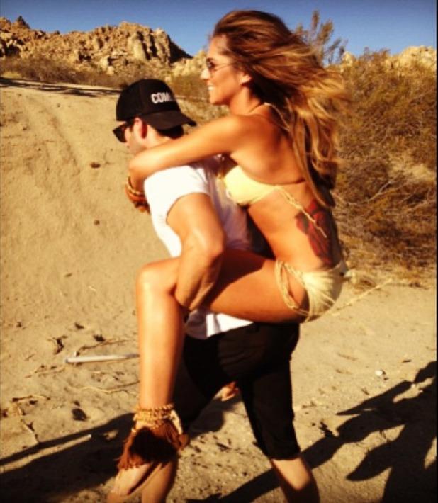 Cheryl Cole gets piggy back ride on the set of her calendar shoot, Oct 12 2013