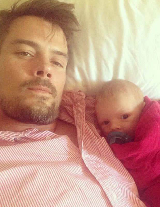 Josh Duhamel and baby Axl Jack watching football, 6 October 2013
