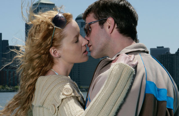 MODEL RELEASED, Couple kissing on a boat 2007