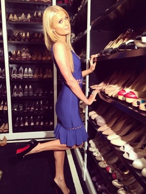 Paris Hilton shows off her shoe collection in her Beverly Hills home.