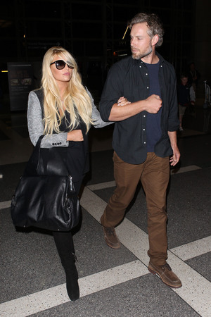 Jessica Simpson and Eric Johnson arrive together at LAX airport - 13.10.2013