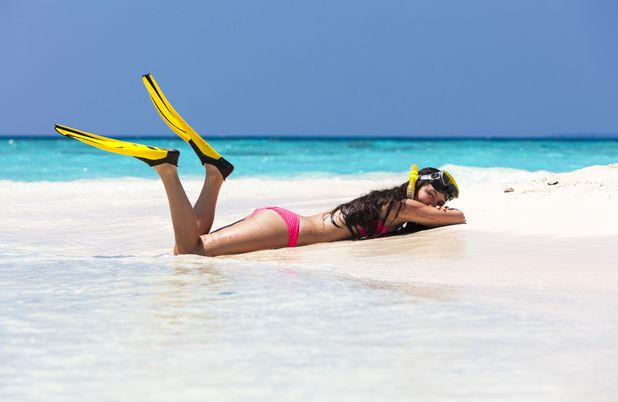 Maldives,Young woman lying in beach 2013