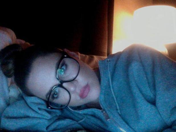 Khloe Kardashian in bed wearing a hoody - 15.10.2013