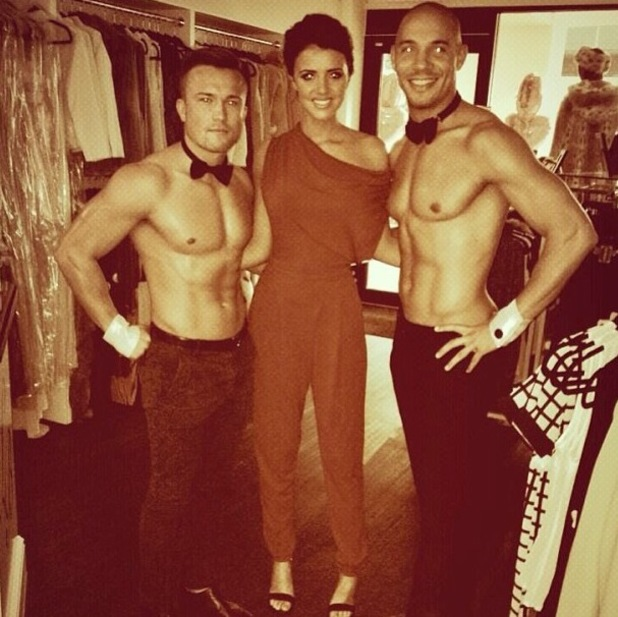 Lucy Mecklenburgh poses alongside two male topless models - 17 OCTOBER 2013