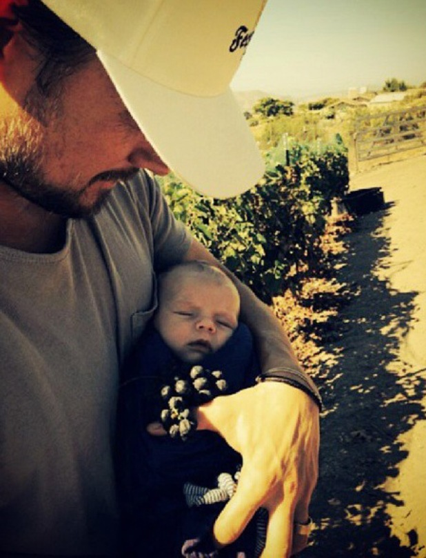 Josh Duhamel holding baby Axl at vineyard