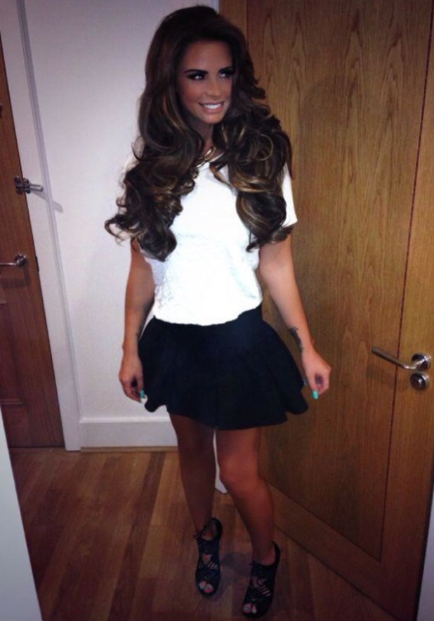 Katie Price wears big hair extensions and mini skirt to Pure Beauty Awards - 17 October 2013