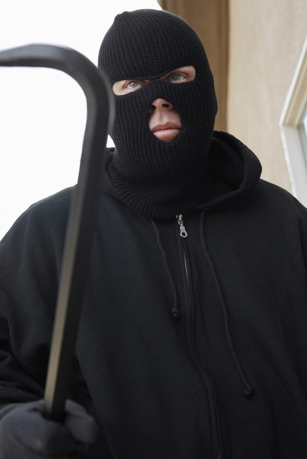 MODEL RELEASED Man wearing balaclava and holding crowbar 2000s