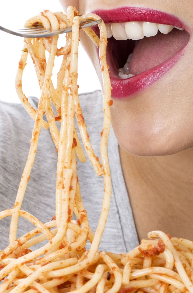 Model Released - Attractive Young Woman Eating Spaghetti Sep 2013