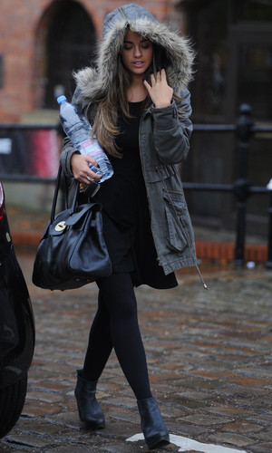 Georgia May Foote wraps up warm in the Manchester rain as she leaves Key 103 radio station where she had co presented the breakfast show - 21 October 2013