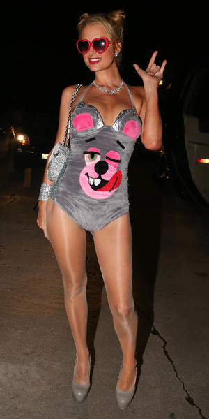 Paris Hilton dresses up as Miley Cyrus and sticks her tongue out like Miley outside Hugh Hefner's Playboy Mansion Halloween Party, Oct 26 2013