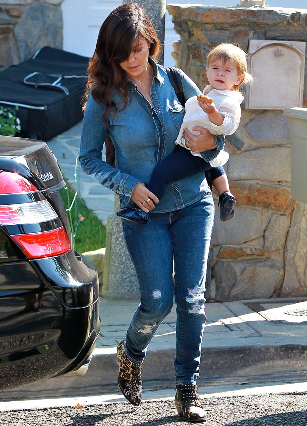 Kourtney Kardashian wearing double denim, takes her baby daughter, Penelope Disick to First Class in Beverly Hills - 23 October 2013