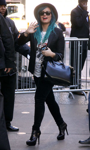 Demi Lovato greets fans while on her way to Good Morning America to promote her new book 'Staying Strong', 24 October 2013