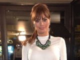 TOWIE's Chloe Sims wears white long sleeve top and leather look mini skirt for night out.