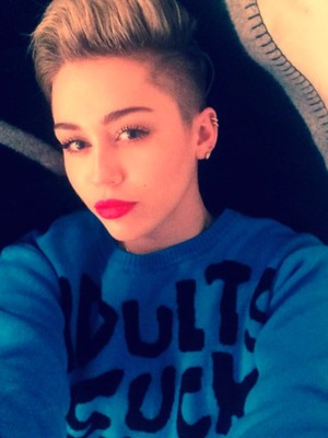 Miley Cyrus shares snap of her wearing Adults Suck Then You Are One jumper! Nov 2 2013