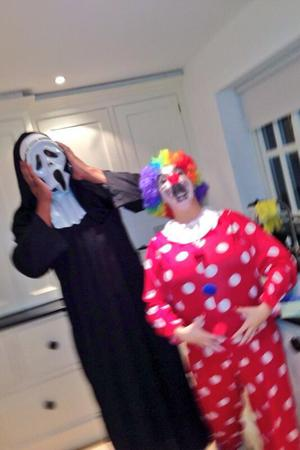 Kerry Katona dresses as a clown for Halloween and poses alongside fiancé George Kay (31 October 2013).