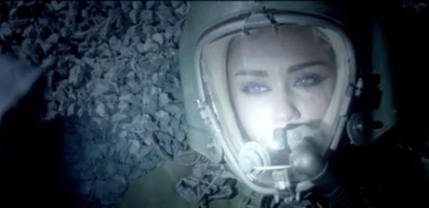 Miley Cyrus dresses as an astronaut in Future's music video for 'Real and True' inspired by Lady Gaga.