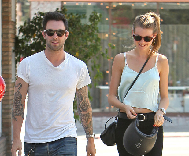 Adam Levine and girlfriend Behati Prinsloo returns to his parked motorcycle after having lunch at Mustard Seed Cafe in Los Feliz. Los Angeles, California - 07.08.12