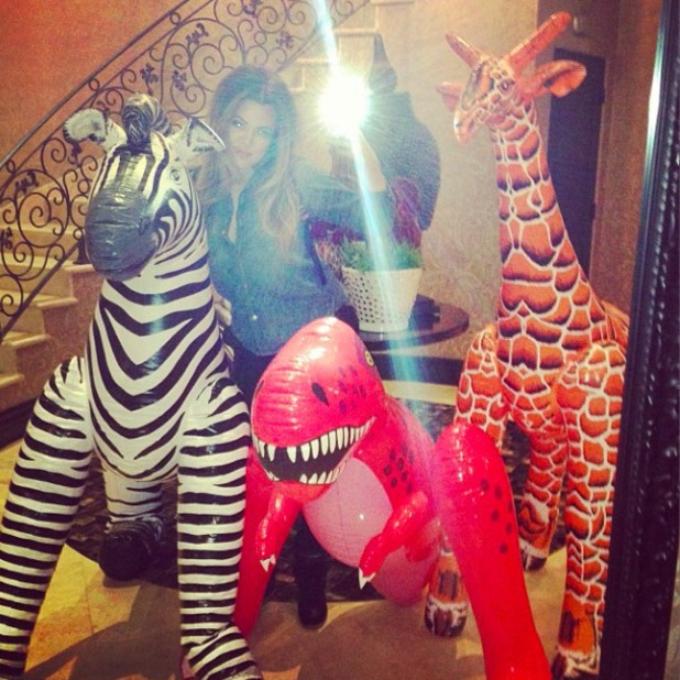 Khloe Kardashian poses with inflatable animals and posts picture on Twitter, Nov 2 2013