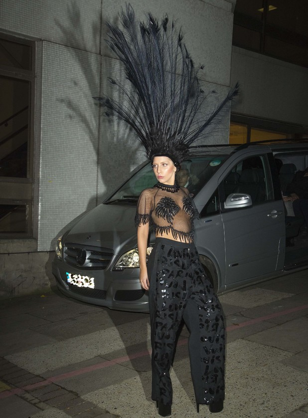 Lady Gaga leaves the ITV studios wearing a large black feathered head dress after appearing on the Graham Norton show - 29 October 2013