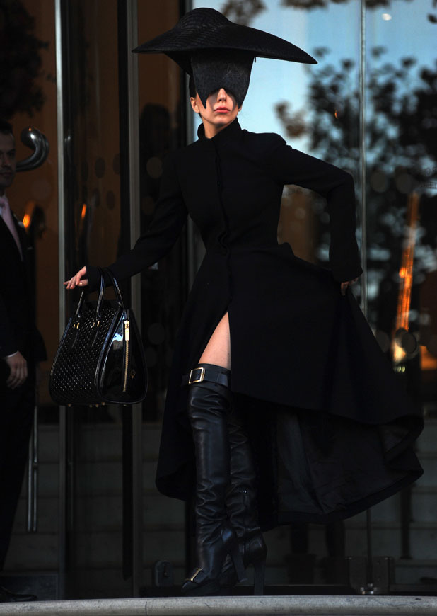 Lady Gaga leaving her london hotel wearing a black head piece, 30 October 2013