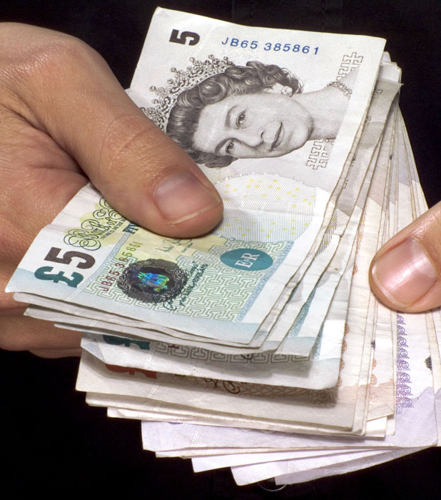 MODEL RELEASED - MAN HOLDING A HANDFUL OF BANKNOTES 10 May 2005