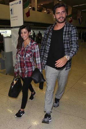 Kourtney Kardashian and Scott Disick wearing matching check shirts arrive at Los Angeles International LAX airport - 6.11.2013