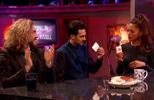 Dynamo performs a card trick on Seann Walsh and Nicole Scherzinger during 'Staying In With Greg and Russell', shown on BBC Three,  	11th January 2013
