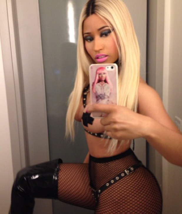 Nicki Minaj wears revealing and topless officer Halloween costume - 31.10.2013