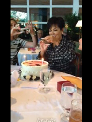 Kris Jenner celebrates 58th birthday with a cake featuring a picture of her face, 5 November 2013