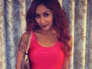 Snooki in a hot pink dress while promoting Supre Tan in Nashville, November 2013