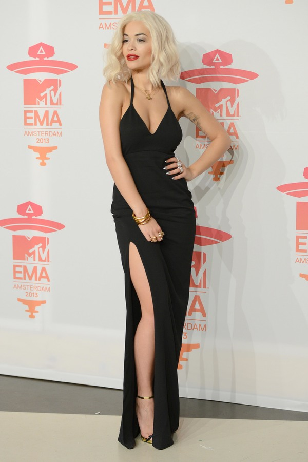 Rita Ora posing on the red carpet in a black dress at the MTV Europe Awards in Amsterdam - 10th November 2013