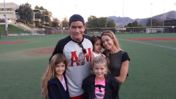 Denise Richards poses with ex-husband Charlie Sheen and their two daughters, and her adoptive daughter Eloise.