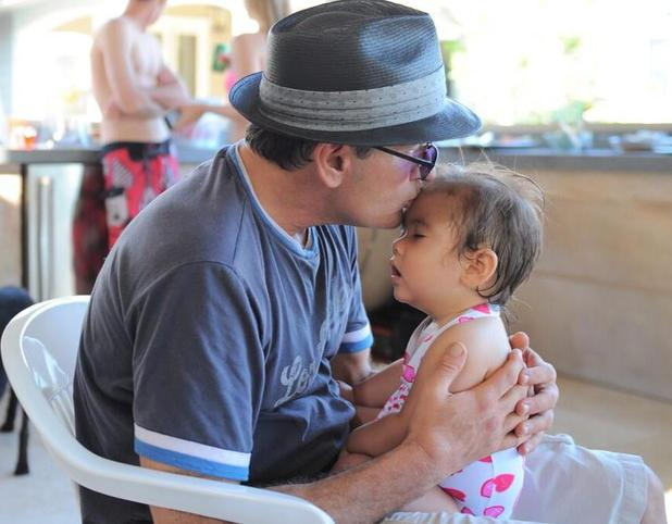Denise Richards shares a photo of Charlie Sheen kissing her daughter Eloise.