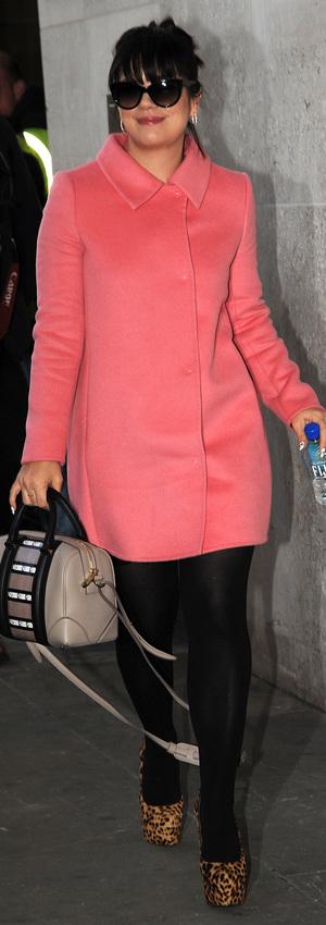 Lily Allen arrives at Radio 1 wearing a pink coat - London 19 November 2013
