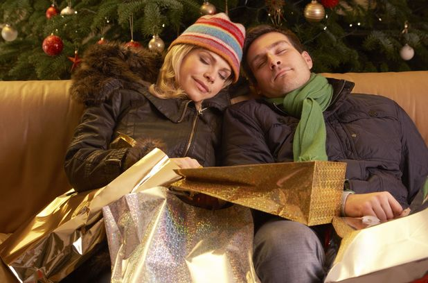 MODEL RELEASED Tired Couple Returning After Christmas Shopping Trip 2011