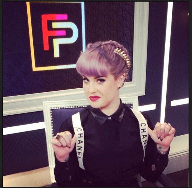 Kelly Osbourne shows off her spiky hairdo and Chanel braces while filming for E! Fashion Police, 21 November 2013