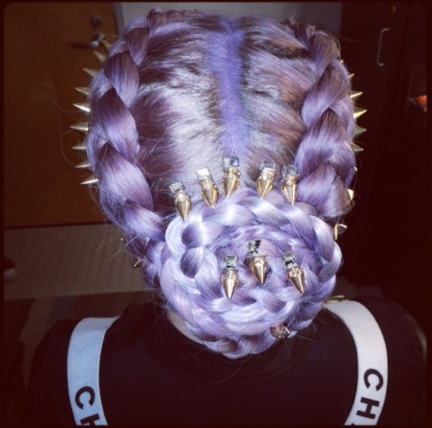Kelly Osbourne shows off her purple spiky hairdo while filming for E! Fashion Police, 21 November 2013