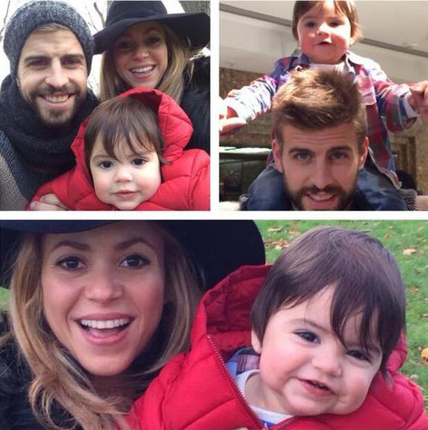 Shakira poses with her son  Milan and boyfriend Gerard Piqué. (18 November 2013)