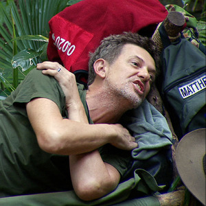 Matthew Wright looks shocked when Alfonso Ribeiro loses his rag with him during I'm A Celebrity, 29 November 2013