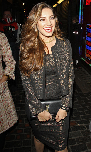 Kelly Brook wears gold and black dress and jacket from her own collection - London, November 26 2013