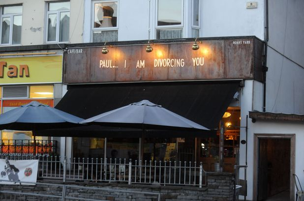 Woman announces plans to divorce cheating husband using bar sign, Swansea, Wales - 25 Nov 2013 'Paul... I am divorcing you' sign above Noah's Yard 25 Nov 2013