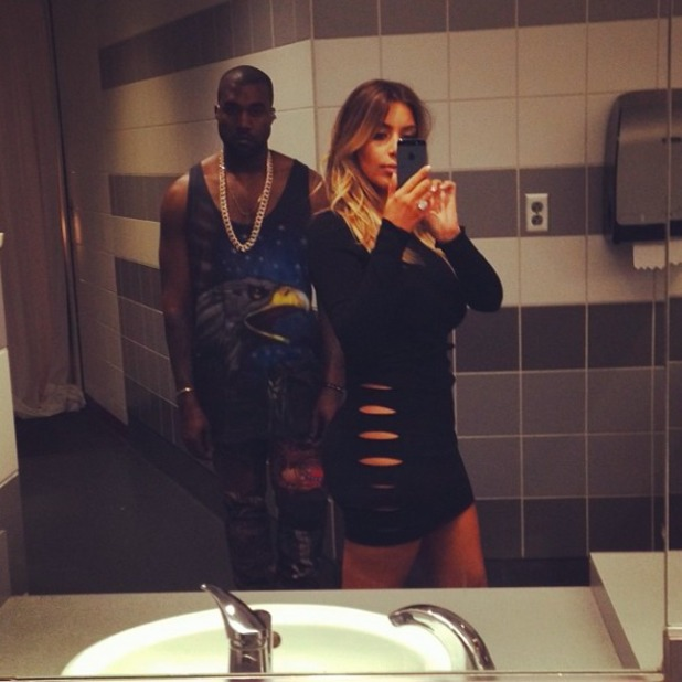 Kim Kardashian poses for selfie with Kanye, wearing LBD dress with no underwear, 29 November 2013
