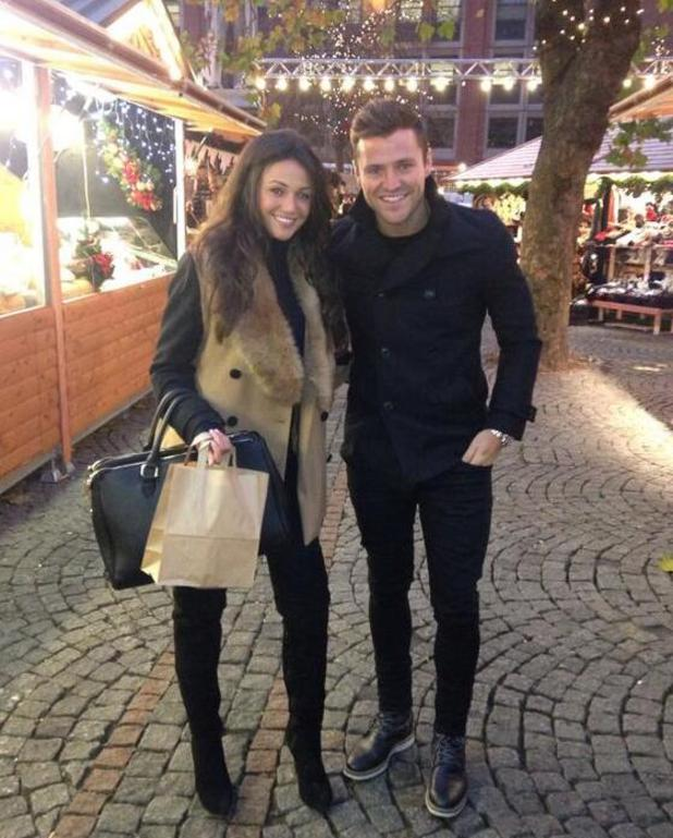 Mark Wright and fiancee Michelle Keegan got in the festive spirit on Tuesday (26 November) as they went Christmas shopping in Manchester.