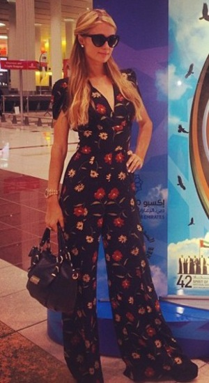 Paris Hilton lands in Dubai on 30 November 2013