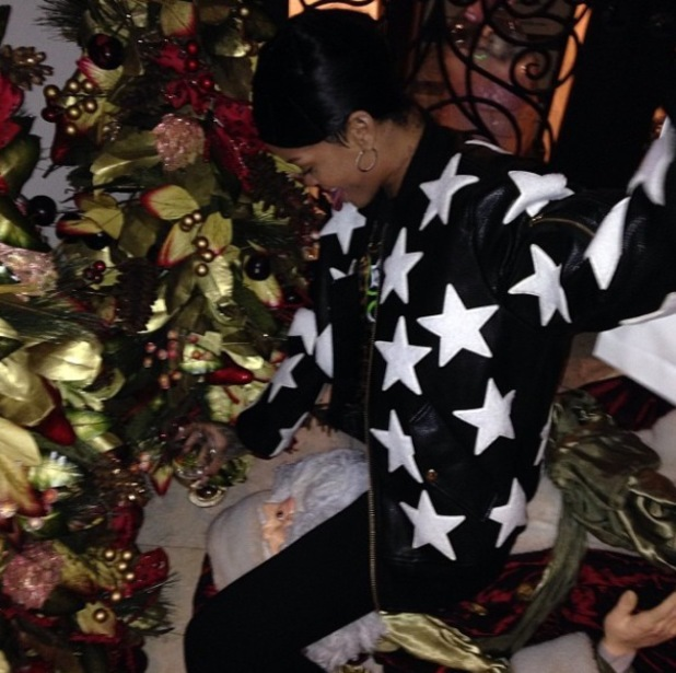 Rihanna sits on top of Santa Claus - joined by friend Melissa Forde - 30.11.2013