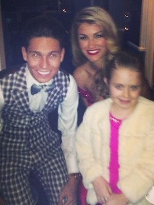 Joey Essex, Amy Willerton and Chloe Sims' daughter Madison at Joey's welcome home party. 12 December.
