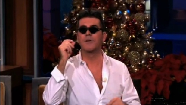 Simon Cowell tries on baby glasses while on The Tonight Show With Jay Leno - 10 December 2013