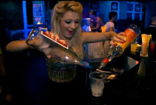 Girl pouring alcoholic drinks in a bar in Kavos - What Happens In Kavos show on Channel 4 December 2013
