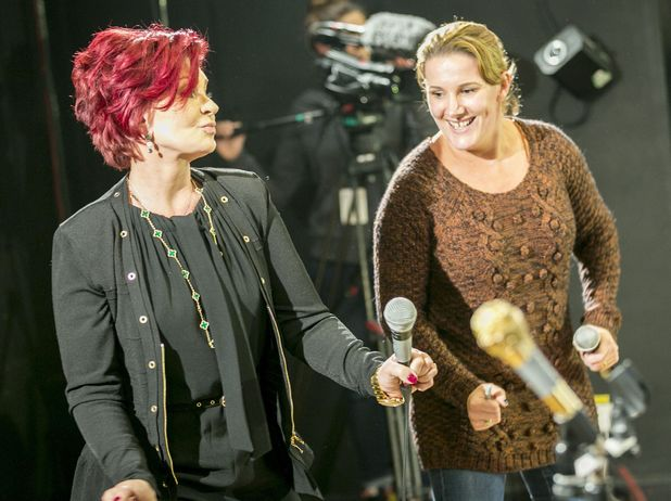 Sam Bailey and Sharon Osbourne on stage performing karaoke at Sam's homecoming party, Leicester, Britain - 12 Dec 2013