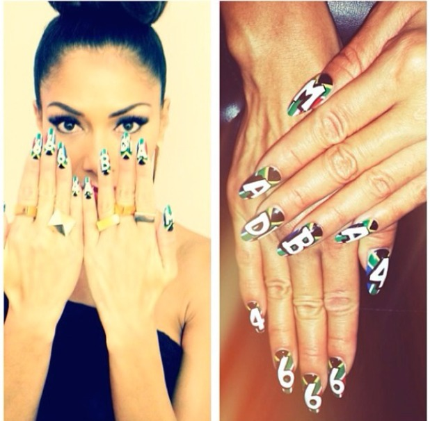 Nicole Scherzinger shows off her nails from Saturday's The X Factor, supporting Nelson Mandela with South Africa flags and 'Madiba' on one hand and '46664' on the other, 9 December 2013